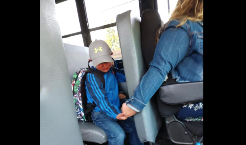 A Wisconsin bus driver, Isabel Lane, comforts a student on his first day of school. (Photo: Facebook)