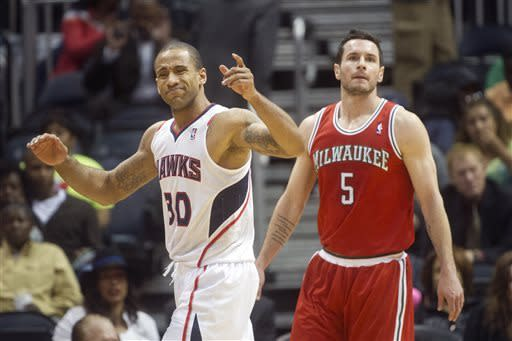 Atlanta Hawks forward Dahntay Jones (30) reacts when called for a foul as Milwaukee Bucks guard J.J. Redick (5) looks on during the first half of an NBA basketball game on Friday, April 12, 2013, in Atlanta. (AP Photo/John Amis)