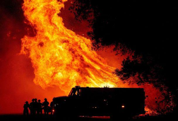 PHOTO: Butte county firefighters watch as flames tower over their truck at the Bear fire in Oroville, Calif., on Sept. 9, 2020. (Josh Edelson/AFP via Getty Images)