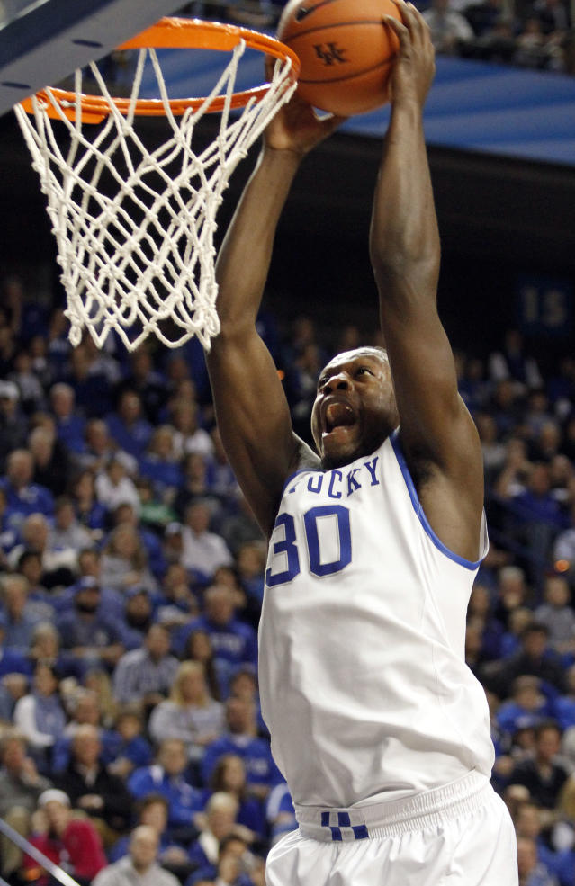 Kentucky's Julius Randle (30) dunks during the second half of an NCAA college basketball game against Eastern Michigan, Wednesday, Nov. 27, 2013, in Lexington, Ky. Kentucky won 81-63. (AP Photo/James Crisp)