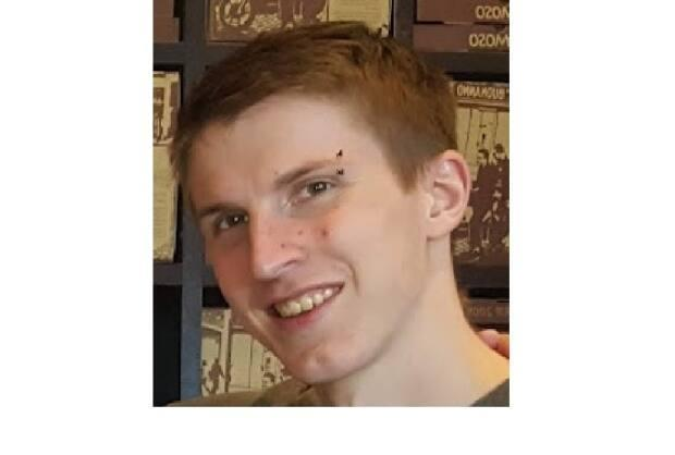 Christopher Dafoe is about six-feet-one, with a slim build and red hair. He has a piercing on his right eyebrow. (Submitted by Edmonton Police Service - image credit)