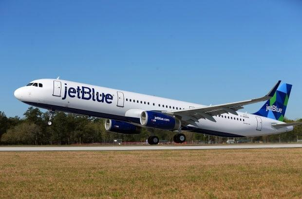 A JetBlue Airbus A-321 aircraft takes off in the U.S. in 2016. The low-cost carrier is planning to come to Vancouver next year.  (Sharon Steinmann/AL.com via AP - image credit)