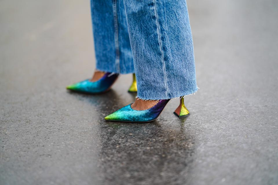 PARIS, FRANCE - DECEMBER 12: Carrole Sagba wears blue ripped jeans from Zara, blue and green shiny pointy glittering shoes from Amina Muaddi, on December 12, 2020 in Paris, France. (Photo by Edward Berthelot/Getty Images)