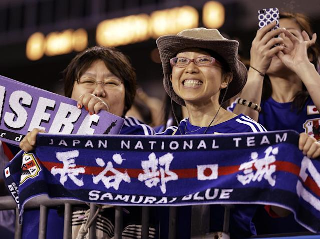 Japan fans cheer their team on during the first half of a friendly soccer match against Costa Rica Monday, June 2, 2014, in Tampa, Fla. (AP Photo/Chris O'Meara)