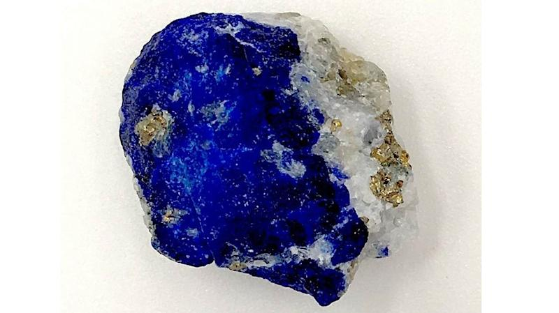 This undated photo released by the Max Planck Institute for the Science of Human History in Jena, Germany, shows a piece of lapis lazuli. During the European Middle Ages, Afghanistan was the only known source of the rare blue stone which at the time was ground up and used as a pigment. Modern-day scientists who examined the 1,000 year-old remains of a middle-aged woman in Germany discovered the semi-precious stone in the tartar on her teeth. From that, they concluded the woman was an artist involved in creating illuminated manuscripts, a task usually associated with monks. The find is considered the most direct evidence yet of a woman taking part in the making of high-quality illuminated manuscripts, the lavishly illustrated religious and secular texts of the Middle Ages. And it corroborates other findings that suggest female artisans were not as rare as previously thought. (Christina Warinner/Max Planck Institute for the Science of Human History via AP)