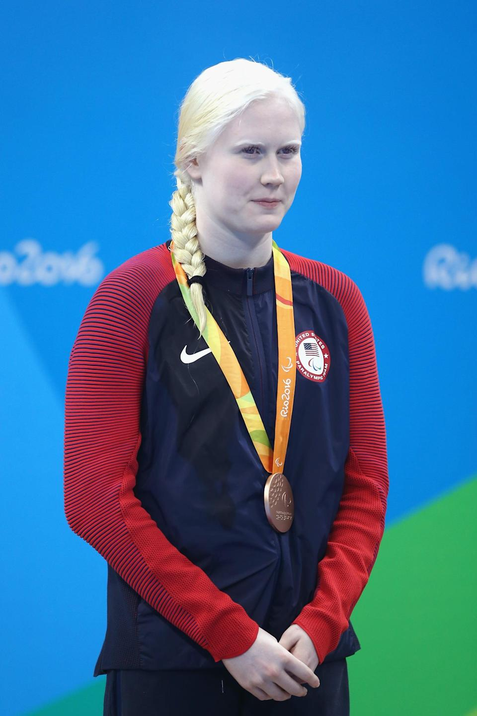 """<p>At <a href=""""http://olympics.com/tokyo-2020/paralympic-games/en/results/swimming/athlete-profile-n1690669-young-colleen.htm"""" class=""""link rapid-noclick-resp"""" rel=""""nofollow noopener"""" target=""""_blank"""" data-ylk=""""slk:14 years old and 64 days"""">14 years old and 64 days</a> in 2012, Young was indeed the youngest Paralympian to represent Team USA in London. While she didn't medal in London, Young went on to compete in the SB13 women's 100m Breaststroke at the 2016 Rio Games and earn a bronze medal. Tokyo is her third Paralympic Games.</p>"""
