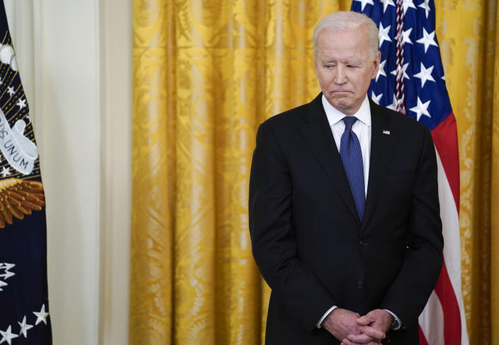 President Joe Biden looks towards the table with the COVID-19 Hate Crimes Act on it before the signing in the East Room of the White House, Thursday, May 20, 2021, in Washington. (AP Photo/Evan Vucci)