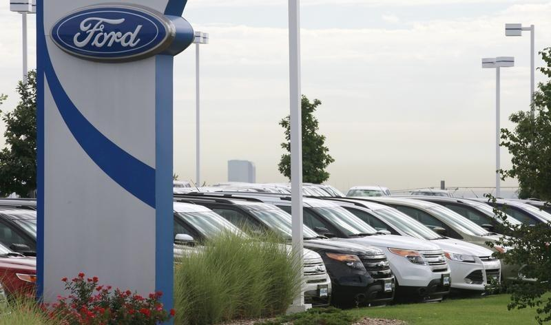 Cars are lined up for sale at a Ford dealer in Lakewood