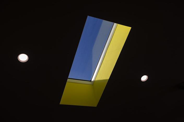 A skylight at Casita L.A. painted yellow