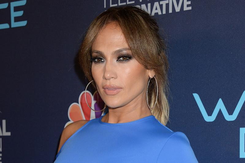 fb473e8746055 Jennifer Lopez Did the No-Bra Trend With a White Top and Matching Luxe  Sneakers