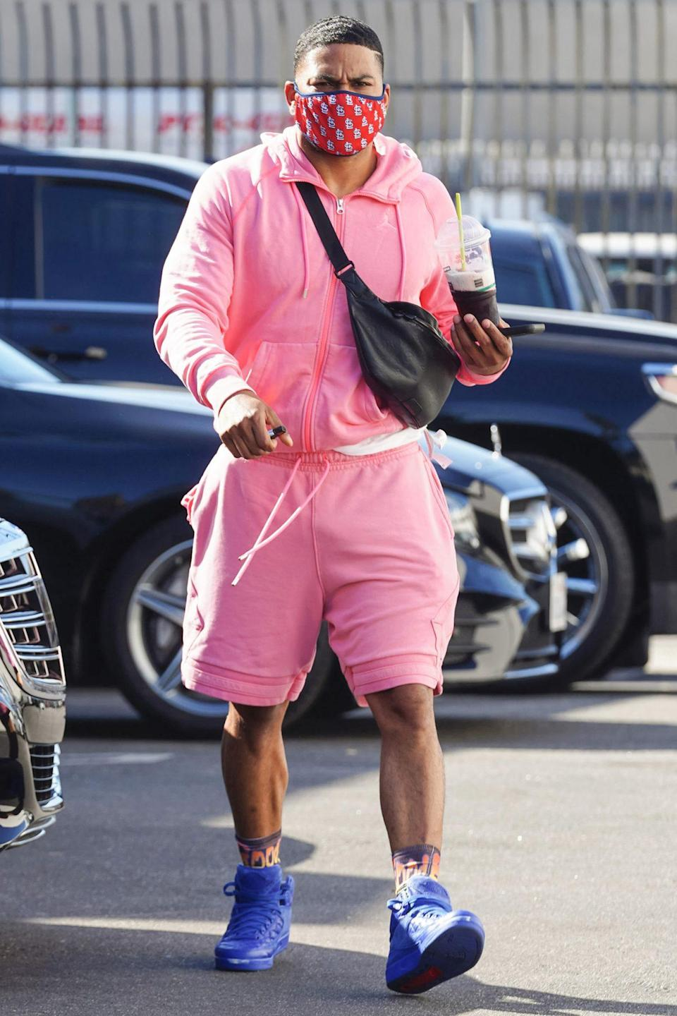 <p>Nelly arrives at the<i> Dancing with the Stars </i>rehearsal studio in a pink sweatsuit and purple sneakers on Wednesday in L.A. </p>