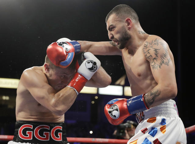 Gennady Golovkin, left, tries to avoid a right from Vanes Martirosyan during their middleweight title boxing match Saturday, May 5, 2018, in Carson, Calif. Golovkin won the bout. (AP Photo/Chris Carlson)