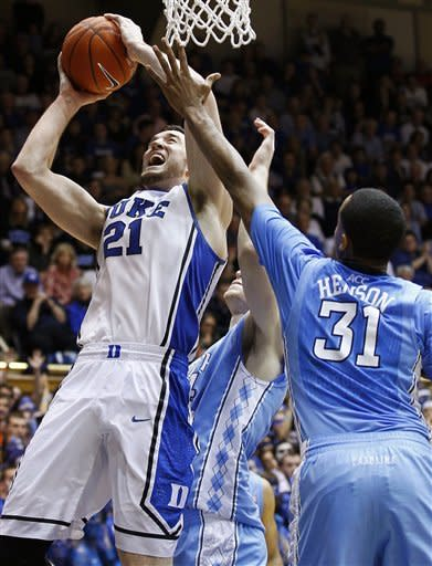 Duke's Miles Plumlee (21) tries to shoot as North Carolina's John Henson (31) defends during the second half of an NCAA college basketball game in Durham, N.C., Saturday, March 3, 2012. North Carolina won 88-70. (AP Photo/Gerry Broome)