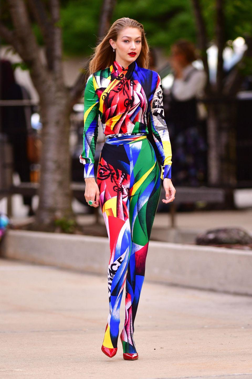<p>In colorful Versace catsuit and red pumps while attending the 2018 CFDA Awards</p>