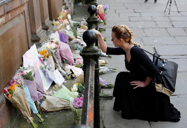 <p>A woman lays flowers for the victims of the Manchester Arena attack, in central Manchester, Britain on May 23, 2017. (Darren Staples/Reuters) </p>