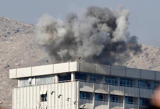 <p>Smoke billows from the Intercontinental hotel after an attack by armed gunmen in Kabul, Afghanistan on January 21, 2018. At least 18 people, including 14 foreigners, were killed in an attack on the Intercontinental Hotel in the Afghan capital Kabul. The attack, which has since been claimed by the Taliban, began on the evening of January 20, just as guests were dining in the restaurant area, and lasted close to 12 hours before Afghan security forces were able to put an end to the ordeal. (Photo: Jawad Jalali/EPA-EFE/REX/Shutterstock) </p>