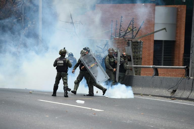 Riot police clash with demonstrators protesting against Venezuelan President Nicolas Maduro's government, in Caracas, on April 10, 2017