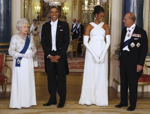 Simply stunning: Have no fear—she looked amazing. We took a look at some of her top outfits from the trip; here, the president and first lady pose with Queen Elizabeth II and Prince Phillip before a banquet at Buckingham Palace on Tuesday. Photo by: AP