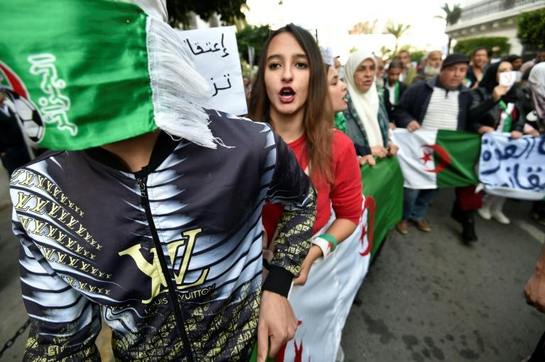 Young people in Algeria have embraced a reformist protest movement that demands new institutions ahead of any vote (AFP Photo/RYAD KRAMDI                        )