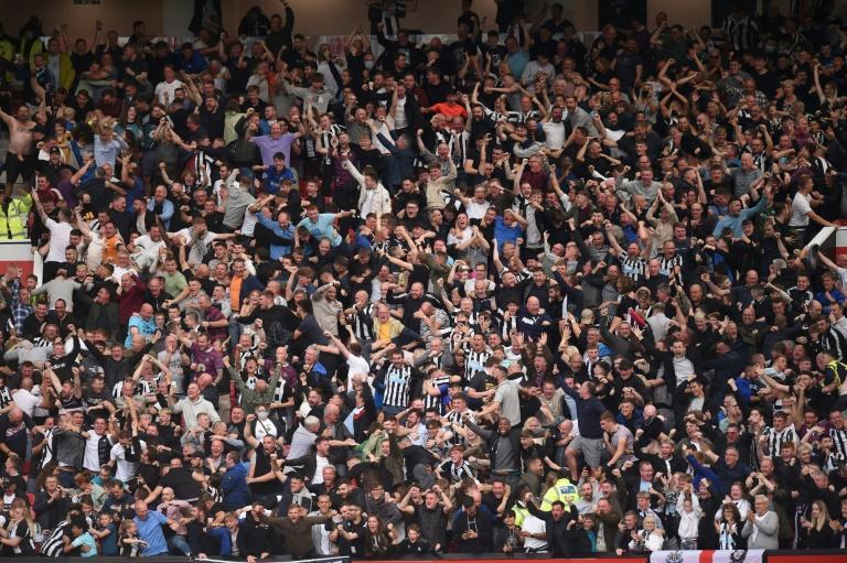 Newcastle United fans have welcomed the Saudi takeover, hoping fresh investment will bring success (AFP/Oli SCARFF)