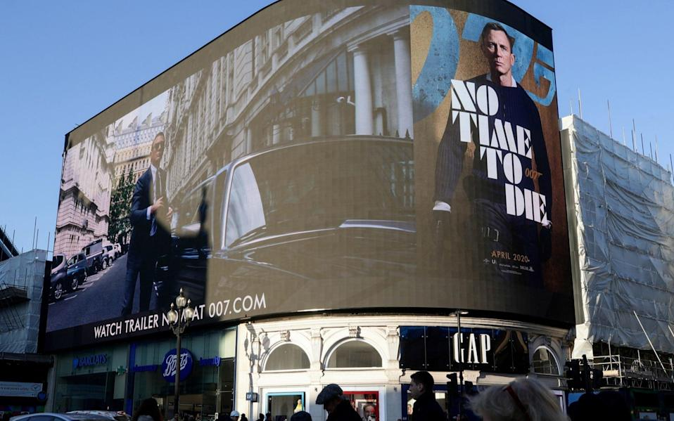 The trailer for No Time Die being shown at Piccadilly Circus in London, December 2019 - Reuters