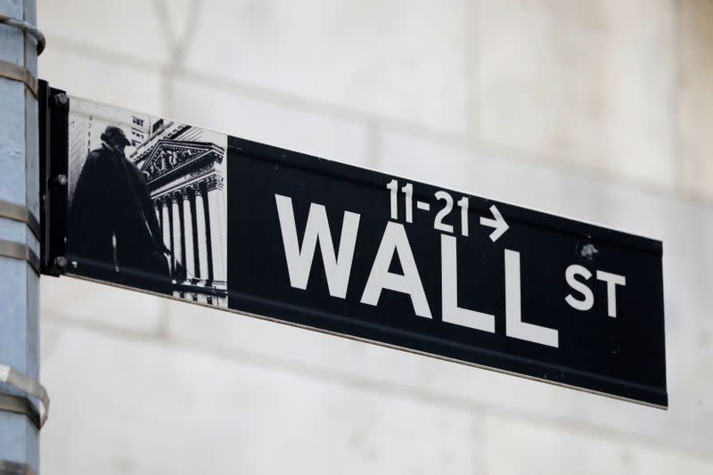 A street sign for Wall Street is seen outside of the New York Stock Exchange (NYSE) in New York City