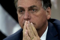 Brazil's President Jair Bolsonaro attends a ceremony at the Ministry of Citizenship, in Brasilia, Brazil, Monday, Aug. 2, 2021. Bolsonaro once again mentioned in his speech the existence of fraud in the Brazilian electoral system. The electoral court has rebuffed his claims as baseless, saying the system is trustworthy and there are several means of checking results. (AP Photo/Eraldo Peres)