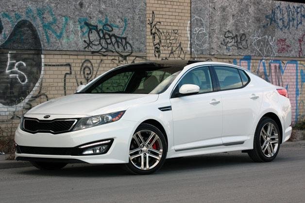 "<p style=""text-align:right;"">  <b><a href=""https://ca.autos.yahoo.com/kia/optima/2013/"" target=""_blank"">2013 Kia Optima 4dr Sdn Auto EX</a></b><br>  <b>TOTAL SAVINGS $3,840</b><br>  <a href=""https://www.unhaggle.com/yahoo/"" target=""_blank""><img src=""https://www.unhaggle.com/static/uploads/logo.png""></a>  <a href=""https://www.unhaggle.com/dealer-cost/report/form/?year=2013&make=Kia&model=Optima&style_id=354277"" target=""_blank""><img src=""https://www.unhaggle.com/static/uploads/getthisdeal.png""></a><br>  </p>  <div style=""text-align:right;"">  <br><b>Manufacturer Suggested Retail Price</b>:  <b>$26,795</b>  <br><br><a href=""https://www.unhaggle.com/Kia/Optima/2013/Incentives/"" target=""_blank"">Kia Canada Incentive</a>*: $3,000  <br>Unhaggle Savings: $840  <br><b>Total Savings: $3,840</b>  <br><br>Mandatory Fees (Freight, Govt. Fees): $1,590  <br><b>Total Before Tax: $24,545</b>  </div>  <br><br><p style=""font-size:85%;color:#777;"">  * Manufacturer incentive displayed is for cash purchases and may differ if leasing or financing. For more information on purchasing any of these vehicles or others, please visit <a href=""http://www.unhaggle.com"" target=""_blank"">Unhaggle.com</a>. While data is accurate at time of publication, pricing and incentives may be updated or discontinued by individual dealers or manufacturers at any time. Vehicle availability is also subject to change based on market conditions. Unhaggle Savings is a proprietary estimate of expected discount in addition to manufacturer incentive based on actual savings by Unhaggle customers  </p>"