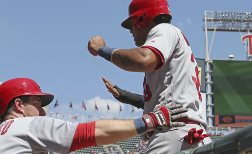 St. Louis Cardinals' Jose Martinez, right, is congratulated by Jedd Gyorko after he scored on a double by Paul DeJong off Minnesota Twins pitcher Taylor Rogers in the fifth inning of a baseball game, Wednesday, May 16, 2018, in Minneapolis. (AP Photo/Jim Mone)