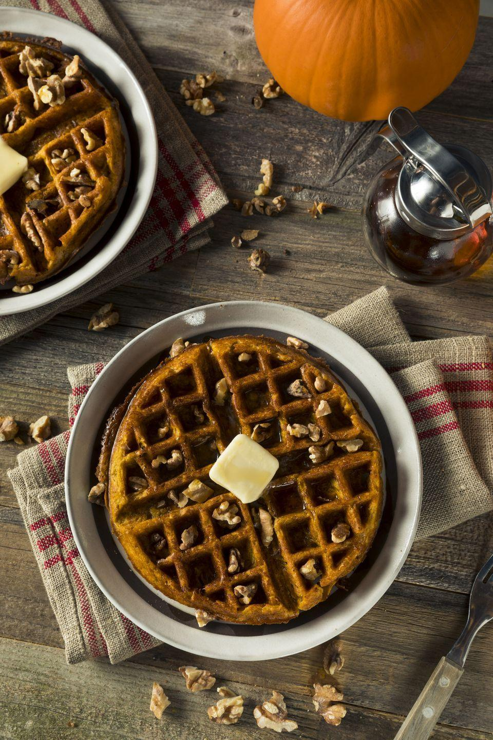 """<p>If you have small children, let them help by choosing easy recipes like pancakes or waffles. The unexpected punch of crystallized ginger gives tender pumpkin waffles a grown-up twist. </p><p><strong><a href=""""https://www.countryliving.com/food-drinks/recipes/a2992/pumpkin-ginger-waffles-recipe/"""" rel=""""nofollow noopener"""" target=""""_blank"""" data-ylk=""""slk:Get the recipe."""" class=""""link rapid-noclick-resp"""">Get the recipe.</a></strong><br></p>"""