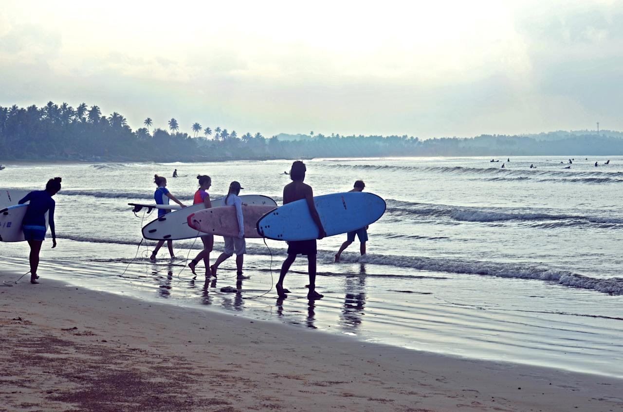 "<p><span>Catch a wave on Sri Lanka's beautiful south coast, before stretching your body and mind on a yoga mat as the sun sets. <a rel=""nofollow"" href=""http://soulandsurf.com"">Soul and Surf</a> has recently opened a hotel between Galle and Weligama, and a week's stay there costs from £675pp, including a double room on a full-board basis, and all daily surf and yoga sessions. [Photo: Soul and Surf]</span> </p>"