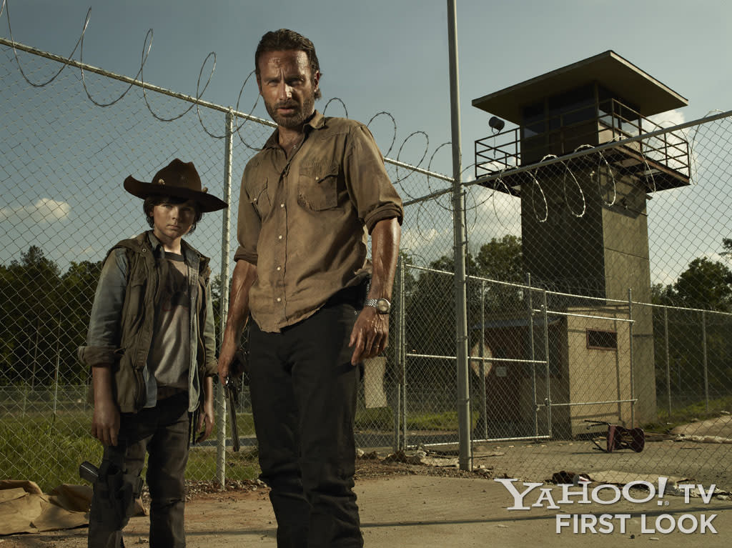 """Carl Grimes (Chandler Riggs) and Rick Grimes (Andrew Lincoln) in """"The Walking Dead"""" Season 3."""