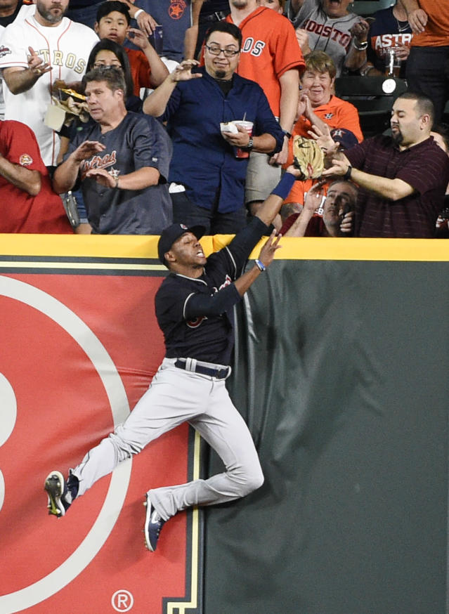 FILE - In this Friday, May 18, 2018 file photo, Cleveland Indians right fielder Greg Allen catches a fly ball hit by Houston Astros' Alex Bregman during the first inning of a baseball game in Houston. Everyone has seen an outfielder receive a tip of the cap or a jubilant fist bump from a pitcher after a home run robbery. This is a story about what happens after they leave the field. (AP Photo/Eric Christian Smith, File)