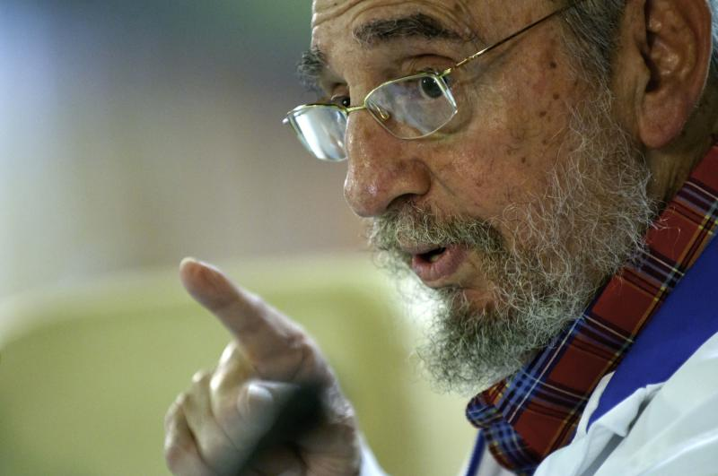 In this photo downloaded from the state media Cubadebate web site, Cuba's leader Fidel Castro, right, speaks during a meeting with students of Cuba's College Students Federation in Havana, Cuba, Wednesday, Nov. 17, 2010. (AP Photo/Roberto Chile, Cubadebate)