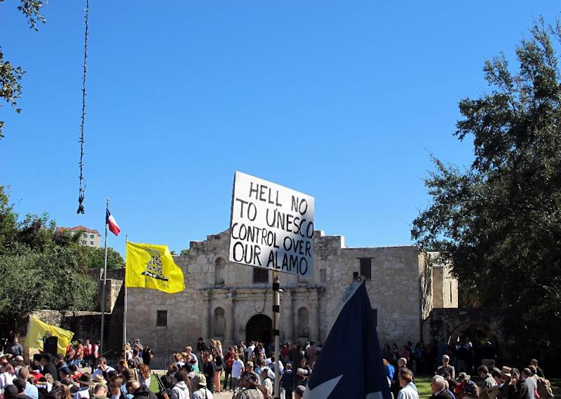 Gun rights advocates gather at the Alamo in San Antonio, Texas on Oct. 19, 2013. Organizers wanted to demonstrate support for an existing state law that allows people to carry long arms, such as rifles and shotguns in public. (AP Photo/Christopher Sherman)
