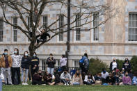 Students and other bystanders gather in the Quad as President Joe Biden and Vice President Kamala Harris hold an event in a nearby building at Emory University, Friday, March 19, 2021, in Atlanta. (AP Photo/Alex Brandon)