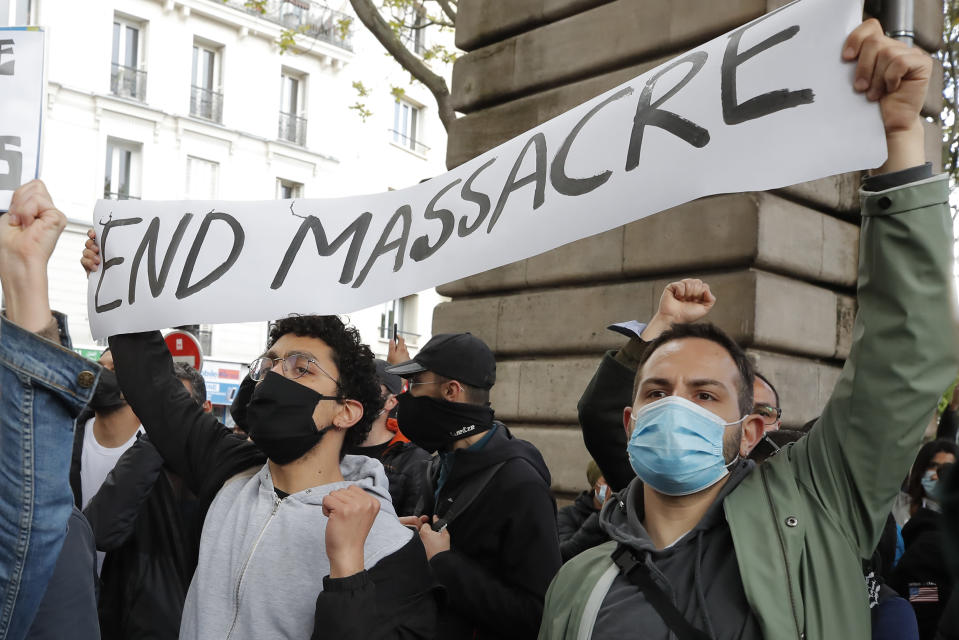 Demonstrators display a banner during a banned protest in support of Palestinians in the Gaza Strip, Saturday, May, 15, 2021 in Paris. Marches in support of Palestinians in the Gaza Strip were being held Saturday in a dozen French cities, but the focus was on Paris, where riot police got ready as organizers said they would defy a ban on the protest. (AP Photo/Michel Euler)