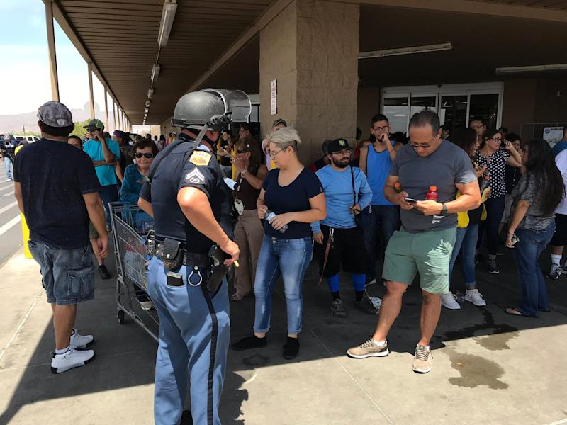 Police interview witnesses to the shooting near Cielo Vista Mall in El Paso on Aug. 3, 2019.