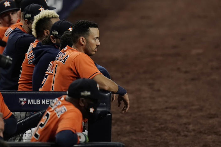 Houston Astros Carlos Correa watches the eighth inning from the dugout in Game 7 of a baseball American League Championship Series, Saturday, Oct. 17, 2020, in San Diego. (AP Photo/Gregory Bull)