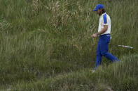 Team Europe's Tommy Fleetwood walks on the 18th hole during the Ryder Cup singles matches at the Whistling Straits Golf Course Sunday, Sept. 26, 2021, in Sheboygan, Wis. (AP Photo/Charlie Neibergall)