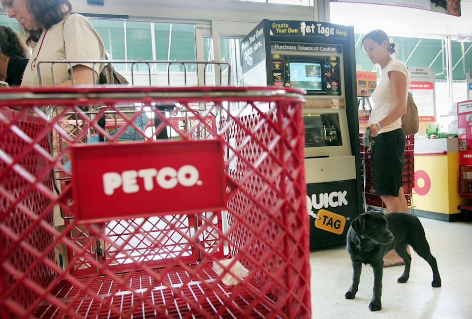 CHICAGO - JULY 14: Shoppers look over the merchadise at a Petco store July 14, 2006 in Chicago, Illinois. Texas Pacific Group and Leonard Green & Partners LP agreed to acquire the animal supplies retailer for $29 a share, 49 percent more yesterday's closing price.  (Photo by Scott Olson/Getty Images)