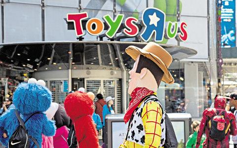Toy Story characters infront of Toys R US's old Times Square store