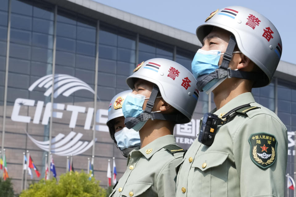 Security personnel stand guard outside the China International Fair for Trade in Services (CIFTIS) in Beijing on China, Thursday, Sept. 2, 2021. Chinese and foreign enterprises are expected to showcase their latest technology and services during the annual China International Fair for Trade in Services this week. (AP Photo/Ng Han Guan)