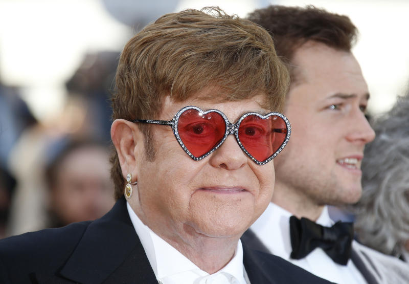 """72nd Cannes Film Festival - Screening of the film """"Rocketman"""" out of competition - Red Carpet Arrivals - Cannes, France, May 16, 2019. Elton John poses. REUTERS/Jean-Paul Pelissier"""
