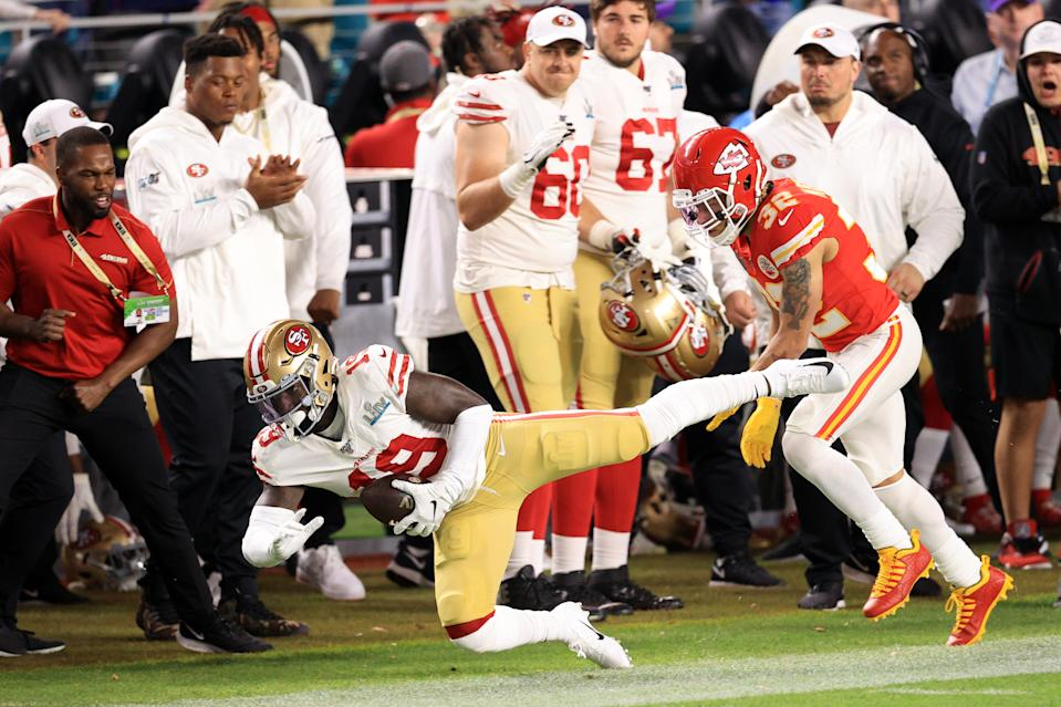 MIAMI, FLORIDA - FEBRUARY 02: Deebo Samuel #19 of the San Francisco 49ers is tackled out of bounds by Tyrann Mathieu #32 of the Kansas City Chiefs in the first quarter in Super Bowl LIV at Hard Rock Stadium on February 02, 2020 in Miami, Florida. (Photo by Andy Lyons/Getty Images)