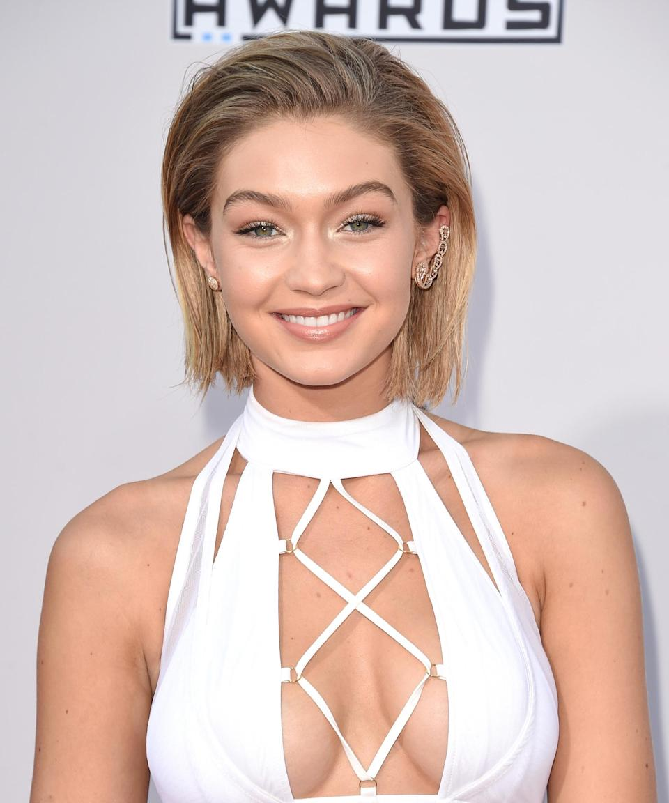"""<h3>2015</h3> <br><br>She hit up the same award show one year later, but walked the red carpet with a stunning <a href=""""https://www.refinery29.com/en-us/2015/11/98167/gigi-hadid-bob-haircut"""" rel=""""nofollow noopener"""" target=""""_blank"""" data-ylk=""""slk:new bob"""" class=""""link rapid-noclick-resp"""">new bob</a> the second time around. Unfortunately for fans of the look, the shorter hairstyle was merely the result of a wig.<span class=""""copyright"""">Photo: Jason Merritt/Getty Images.</span><br><br>"""