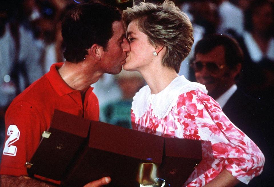 <p>After a polo match, Prince Charles steals a kiss on December 11, 1986 in Oman.</p>