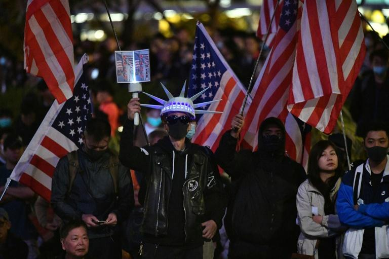 """Hong Kong activists staged a """"Thanksgiving"""" rally saluting President Donald Trump and US lawmakers for their support (AFP Photo/Anthony WALLACE)"""
