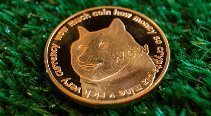 A stock image of a gold Dogecoin (DOGE) on a green textured background.