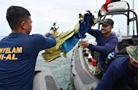 Indonesian Navy divers retrieve wreckage from the Sriwijaya Air Boeing 737-500 aircraft
